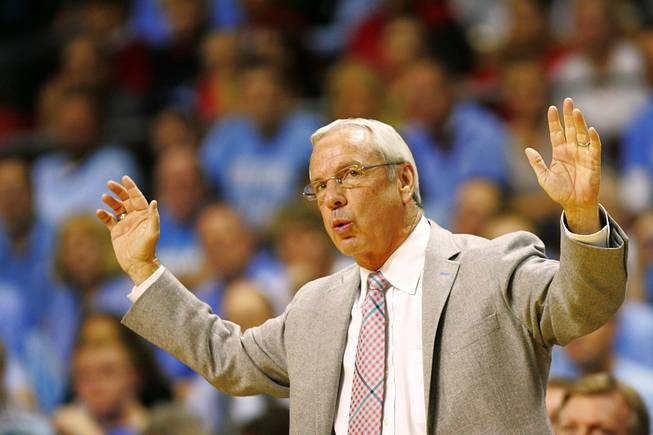 University of North Carolina head coach Roy Williams throws up his hands during their Las Vegas Invitational championship game against UNLV Saturday, Nov. 26, 2011 at the Orleans Arena. The Rebels upset the number one ranked Tar Heels 90-80.