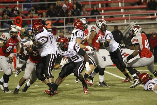 San Diego State Aztec defensive back Rene Siluano (39) looks for an opening through the UNLV defense their game at Sam Boyd Stadium Saturday, November 26 2011.  Photo by Richard Brian
