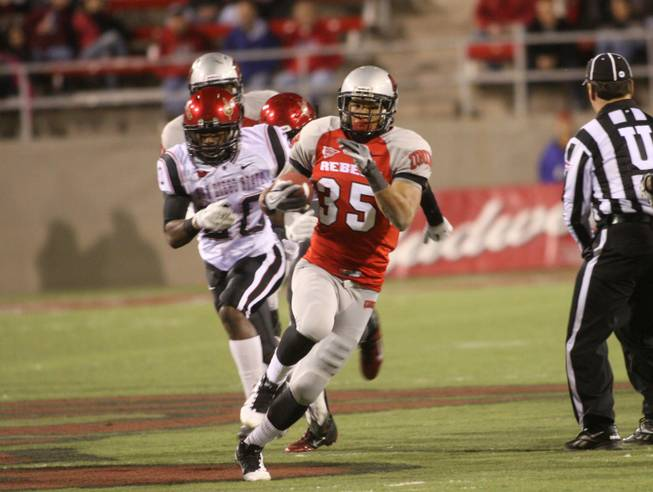 UNLV Rebel running back Tim Cornett (35) runs for a short gain against San Diego State on Saturday, Nov. 26, 2011, at Sam Boyd Stadium.