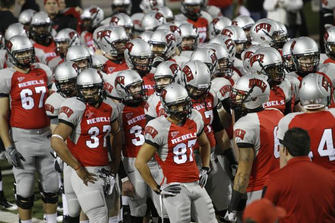 Rebel players prepare to warm up before their game against San Diego State on Saturday, Nov. 26, 2011, at Sam Boyd Stadium.
