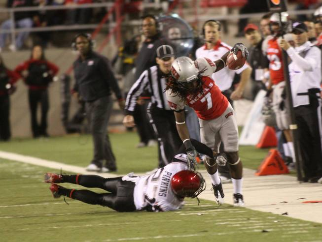 UNLV wide receiver Michael Johnson (7) is pushed out of bounds by San Diego State's player Eric Pinkins during their game Saturday, Nov. 26, 2011.