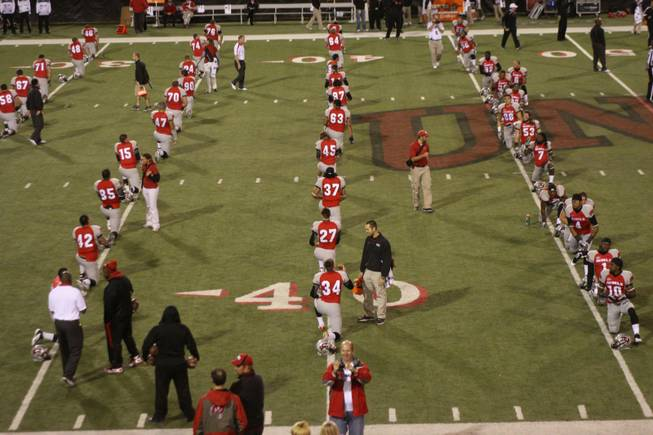 Rebel players warm up before their game against San Diego State on Saturday, Nov. 26, 2011, at Sam Boyd Stadium.
