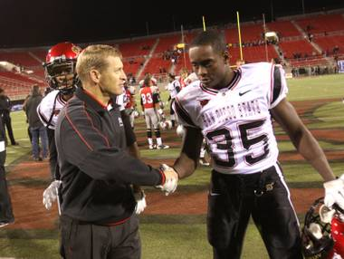UNLV coach Bobby Hauck shakes the hand of San Diego State's Dwayne Garrett after the Rebels lost to the Aztecs on Senior Night, Saturday, Nov. 26, 2011.