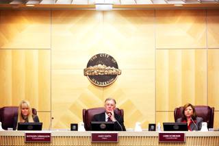 Henderson Mayor Andy Hafen, center, flanked by city council members Kathleen Vermillion, left, and Gerri Schroder, right, listen during the council's meeting Tuesday, Nov. 29, 2011,  in which the council unanimously appointed Josh M. Reid, U.S. Senate Majority Leader Harry Reid's son, to be the next city attorney.