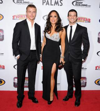 Derek Hough, Cheryl Burke and Mark Ballas at the 2011 Fighters Only World Mixed Martial Arts Awards red carpet at the Palms on Nov. 30, 2011.