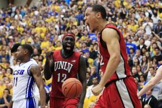 UNLV's Chace Stanback and Brice Massamba celebrate a basket and foul against UC Santa Barbara Wednesday, Nov. 30, 2011 in Santa Barbara. UNLV won the game in double overtime 94-88.