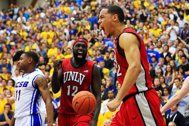 UNLV's Chace Stanback and Brice Massamba celebrate a basket and foul against UC Santa Barbara Wednesday, Nov. 30, 2011, in Santa Barbara. UNLV won the game in double overtime, 94-88.