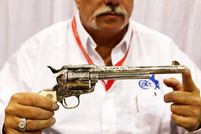 A Colt single action army six shooter with engraving at the Colt booth at the Cowboy Christmas Gift Show at the Las Vegas Convention Center in Las Vegas Thursday, Dec. 1, 2011.