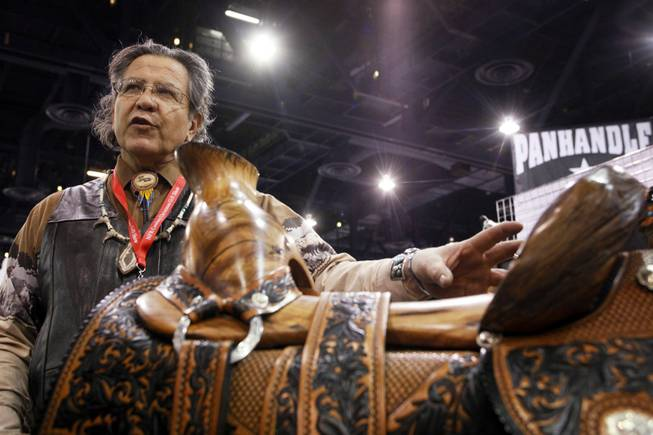 A wooden saddle carved by Andy Sanchez of Algodones, New Mexico for sale for $25,000 at the Cowboy Christmas Gift Show at the Las Vegas Convention Center in Las Vegas Thursday, Dec. 1, 2011.