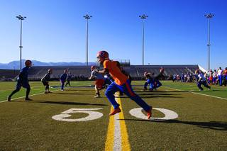 Bishop Gorman players practice at Damonte Ranch High School Friday, Dec. 2, 2011 before their state championship game against Reed High School on Saturday.