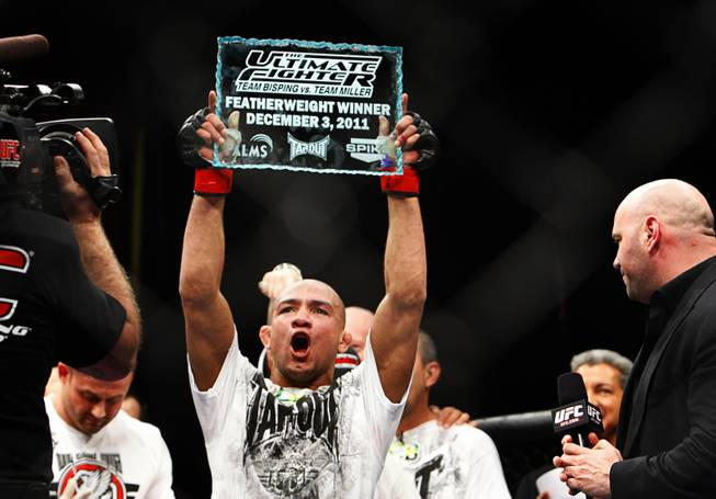 Featherweight fighter Diego Brandao celebrates after defeating Dennis Bermudez at the TUF 14 Finale in the Palms December 3, 2011.