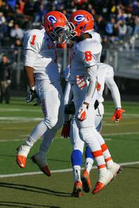 Bishop Gorman's Ryan Smith, left, and Terrence Chambers celebrate Chambers' touchdown against Reed High School of Sparks during the 4A championship football game Saturday, Dec. 3, 2011 at Damonte Ranch High School in Reno. Gorman won their third consecutive title 72-28.
