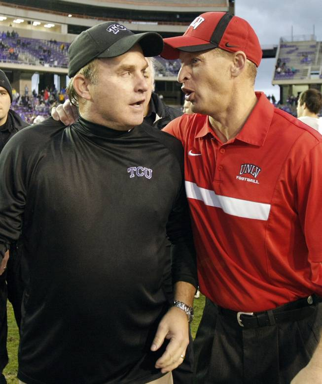 TCU head coach Gary Patterson, left, and UNLV head coach Bobby Hauck greet each other after their game in Fort Worth, Texas. TCU won 56-9.