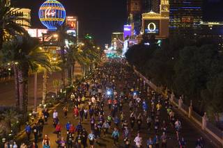 Runners head northbound on the Las Vegas Strip during the Zappos.com Rock 'n' Roll Las Vegas Marathon Sunday, December 4, 2011. The marathon and half-marathon attracted 44,000 official entrants from all 50 states and 54 countries, organizers said.