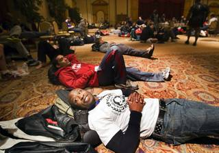 Mixed martial arts fighters Demitrius Turner, bottom, of Savannah, Ga. and Maka Watson of Kauai, Hawaii wait to be called during tryouts for the next season of The Ultimate Fighter at Texas Station Monday, December 5, 2011.