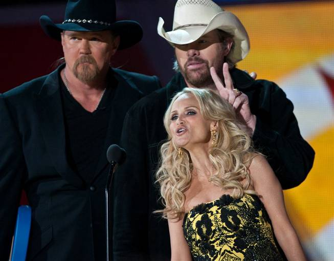 Hosts Trace Adkins, left, and Kristin Chenoweth with Toby Keith at the 2011 American Country Awards at MGM Grand Garden Arena on Dec. 5, 2011.