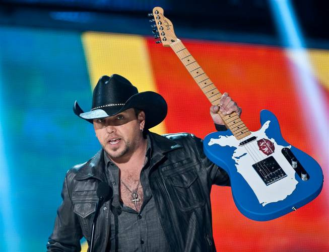 Jason Aldean accepts an award at the 2011 American Country Awards at MGM Grand Garden Arena on Dec. 5, 2011.