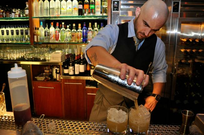 Lead bartender J.R. Starkus of RM Seafood at Mandalay Bay ...