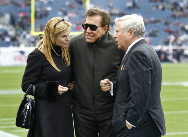 New England Patriots owner Robert Kraft, right, hosts casino mogul Steve Wynn and his wife, Andrea Hissom, on the field at Gillette Stadium prior to the Patriots' NFL football game against the Indianapolis Colts in Foxborough, Mass., Sunday, Dec. 4, 2011.