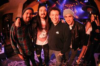 DJ Steve Aoki's 34th birthday at XS in the Encore on Dec. 6, 2011. A friend, DJ Joachim Garraud and Michael Trevino are with Aoki.