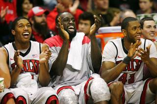 From left, UNLV's Justin Hawkins, Brice Massamba and Mike Moser cheer their teammates on against Cal State San Marcos Wednesday, Dec. 7, 2011, at the Orleans Arena. UNLV won the game, 94-50.