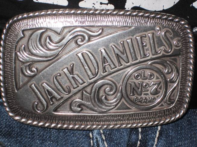 Brittany Pittman's belt buckle touts the Jack Daniel's brand.