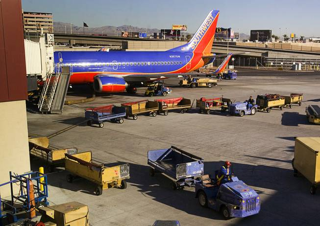 A Southwest Airlines passenger jet is shown at a gate at McCarran International Airport on Dec. 9, 2011.
