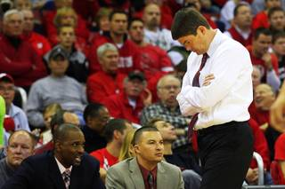 UNLV head coach Dave Rice looks down while walking along the bench during their game against Wisconsin at the Kohl Center in Madison Saturday, Dec. 10, 2011. Wisconsin won the game 62-51, dropping UNLV to 9-2 on the season.