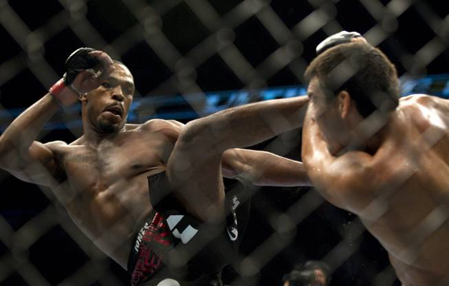 American Jon Jones, left, lands a kick on Brazil's Lyoto Machida during their World Light Heavyweight Championship bout during UFC 140 in Toronto on Saturday, Dec. 10, 2011.