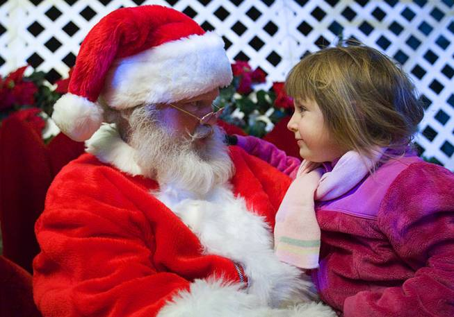 Santa talks with Lauren Nowak, 4, during the Holiday Spectacular at the Springs Preserve, Sunday, December 11, 2011. The Holiday Spectacular will continue on Saturday, Dec. 17 and run through Friday, Dec. 23.  .