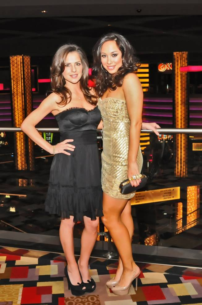 Kelly Monaco and Cheryl Burke at Planet Hollywood on Dec. 9, 2011.