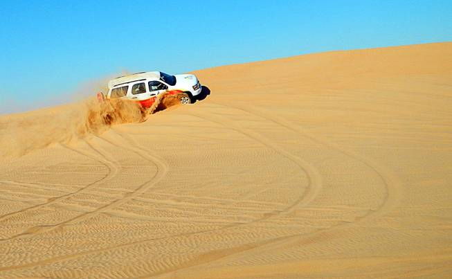 In Dubai, United Arab Emirates, four-wheeling in the sand dunes on the city outskirts. December  2011.