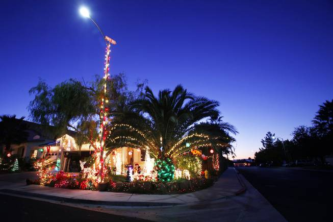 "Dennis and Susan Thomas' home in Henderson, seen on Wednesday, Dec. 14, 2011, won first place in the ""Griswold"" category for the City of Henderson's holiday light contest."