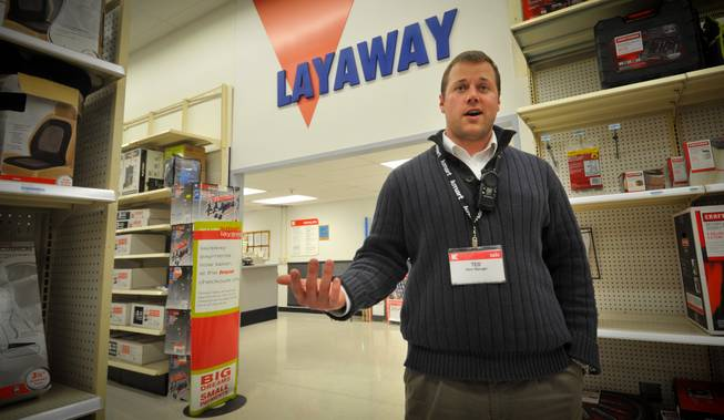 Kmart store manager Ted Straub talks Thursday Dec. 15, 2011, in his Omaha, Neb., store. Dozens of Kmart customers across the country have had their layaways paid off by strangers.