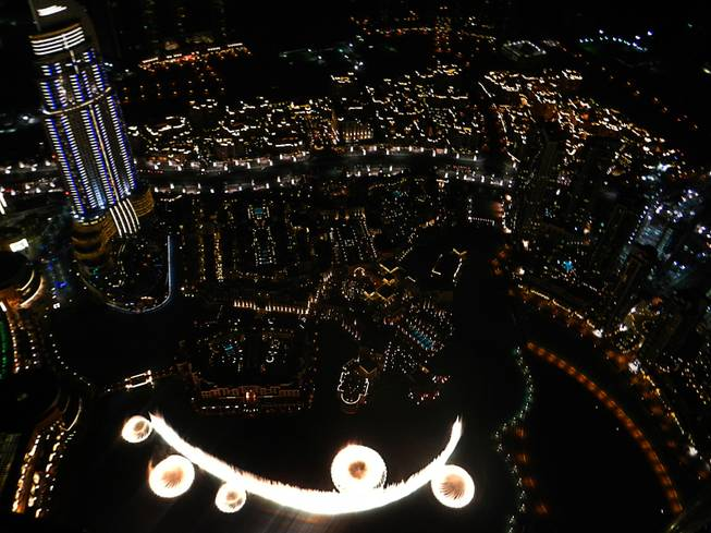 in Dubai, United Arab Emirates, a view of the city and Dubai fountain from the Burj Khalifa observation tower.  December  2011.