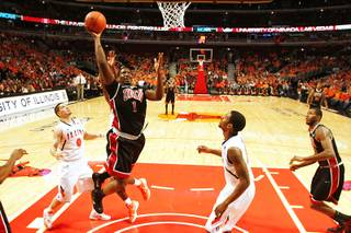 UNLV forward Quintrell Thomas drives to the basket against Illinois Saturday, Dec. 17, 2011 at the United Center in Chicago. Thomas had 13 points in the Rebels 64-48 defeat of 19th ranked Illinois.