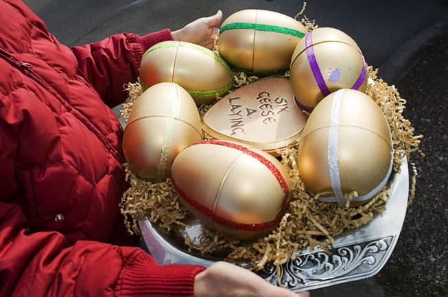 Volunteer Niki English., 13, brings six eggs to the Ramos family in Henderson as part of the 12 Days of Christmas Sunday, December 18, 2011. Inside each egg is a message detailing an adventure that family members will receive during an overnight vacation at the Loews Lake Las Vegas Resort. Twelve Days is a volunteer-based project aiming to bring the 12 days of Christmas to unsuspecting people in the Las Vegas Valley.