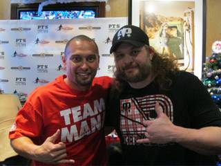 Shane and Melissa Victorino's 2011 Toy Drive at PT's Gold. Shane, left, is pictured here with Roy Nelson.