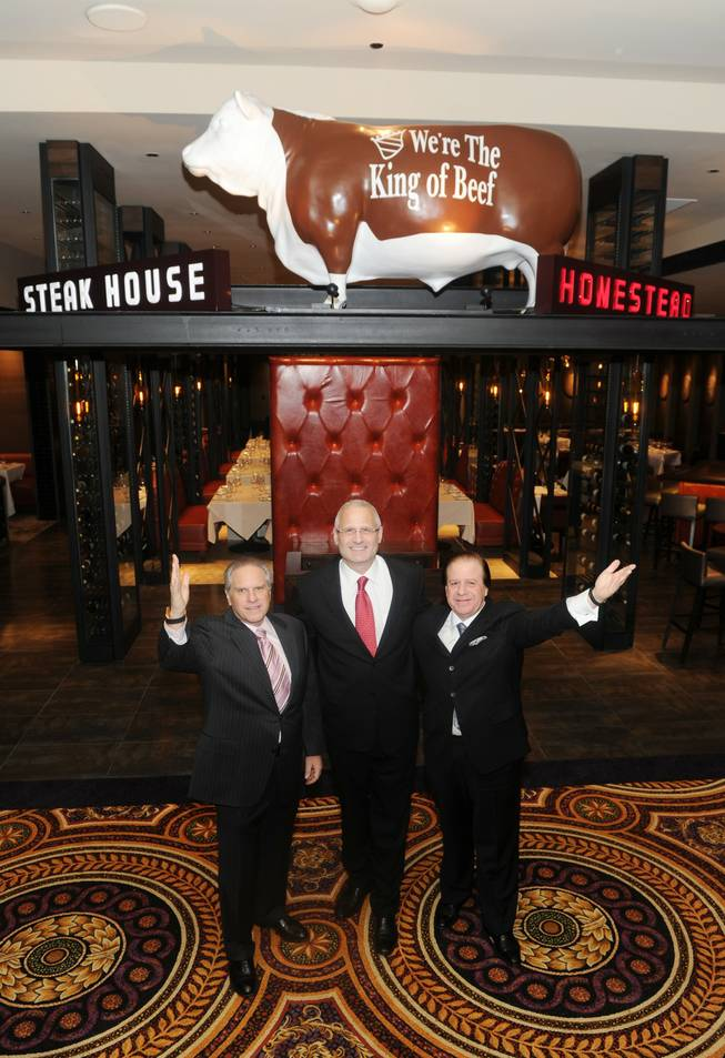 Greg Sherry, Gary Selesner and Marc Sherry at Homestead Steak House in Caesars Palace.
