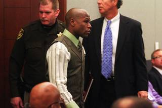 Boxer Floyd Mayweather Jr. arrives in court to plead guilty on domestic violence charges Wednesday, Dec. 21, 2011 at the Clark County Regional Justice Center. Mayweather received a six month sentence and will have to spend 90 days in jail.