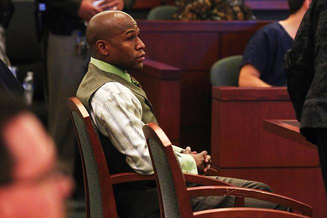 Boxer Floyd Mayweather Jr. appears in court to plead guilty on a domestic violence charge Wednesday, Dec. 21, 2011, at the Clark County Regional Justice Center. Mayweather received a six-month sentence and will have to spend 90 days in jail.