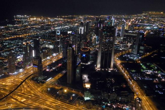 A view of Dubai's city center is shown from the Burj Khalifa's observation tower.