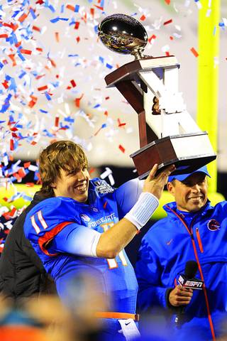 Boise State quarterback Kellen Moore hoists the Maaco Bowl Las Vegas trophy after the Broncos defeated Arizona State 56-24 Thursday, Dec. 22, 2011 at Sam Boyd Stadium.