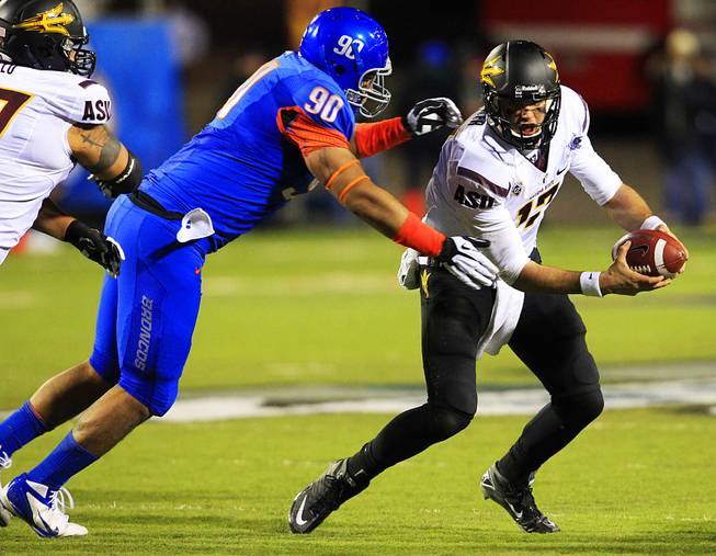 Boise State tackle Billy Winn chases down Arizona State quarterback Brock Osweiler during the Maaco Bowl Las Vegas Thursday, Dec. 22, 2011 at Sam Boyd Stadium. Boise State won the game 56-24.