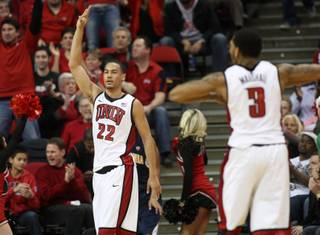 UNLV's Chace Stanback signals after hitting a 3-pointer in the first half of the Rebels' game against California on Friday, Dec. 23, 2011.
