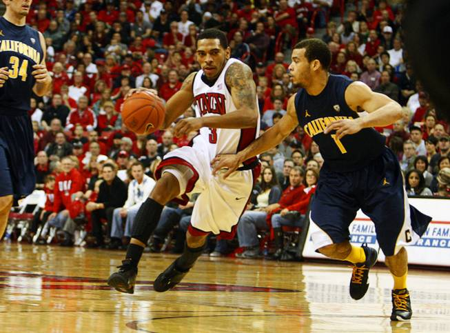 UNLV's Anthony Marshall is covered by Cal's Justin Cobbs as he takes the ball down court at the Thomas and Mack Center Friday, December 23, 2011. STEVE MARCUS