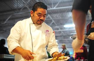 Executive Chef Juan Carlos Penate garnishes a dish at the Catholic Charities of Southern Nevada on Dec. 25, 2011. The nonprofit served more than 1,500 people at its annual Christmas dinner.