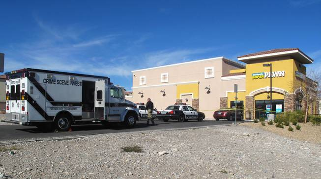 A man who apparently tried to rob a pawn shop was shot to death Wednesday, Dec. 28, 2011, after exchanging gunfire with an employee at the Cash America SuperPawn store in the 7000 block of North Durango Drive, according to Metro Police.