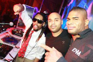 Alistair Overeem, with Lil Jon and Sidney Samson, celebrates his UFC 141 victory at Surrender on Dec. 30, 2011.