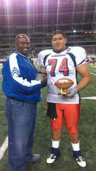 Desert Pines High School football coach Paul Bennett and Jaguars senior offensive tackle Cedrick Poutasi pose for a picture at Cowboys Stadium in Arlington, Texas, after Poutasi was named the top lineman Offense-Defense All-American Bowl. The 6-foot-6, 325 pound Poutasi also verbally committed to Utah during the game.